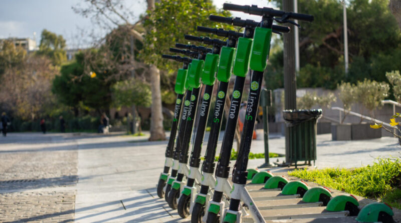 Row of electric scooters for rent